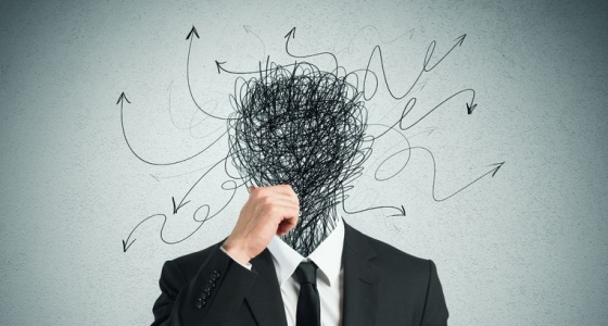 27430478 - confused businessman with arrows and lines in head